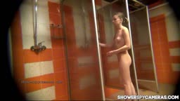 Tiny blonde in the shower watched by hidden cam