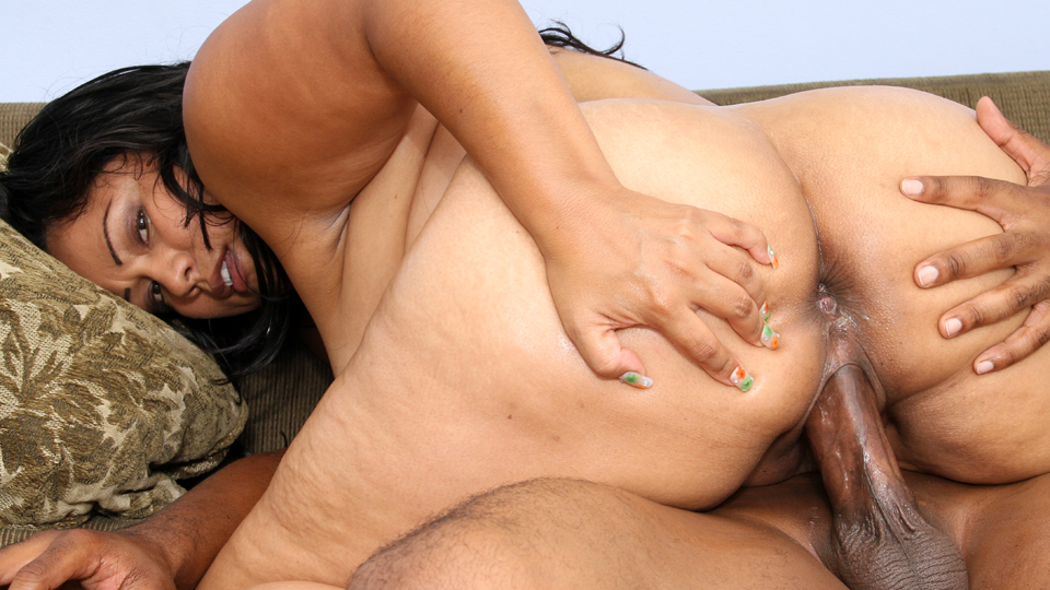Chubby red haired chick is sucking a fat, black cock and getting fucked